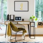 Image of light room with large windows and comfortable home office desk