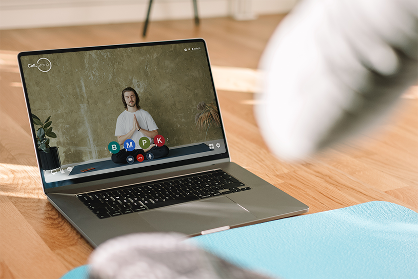 woman doing online yoga video conference